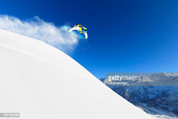 Freestyle snowboarder in a jump