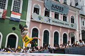 Freestyle soccer athlete Soufiane El Marnissi of Belgium competes on the Pelourinho square during the qualification for the Red Bull Street Style...