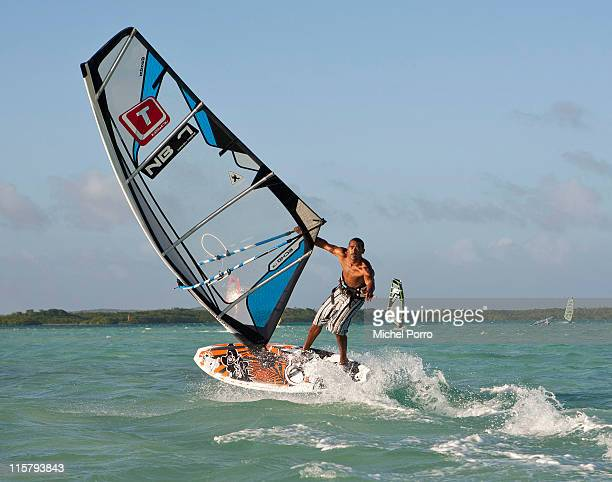 Freestyle windsurfing competitor Tonkie Frans of Bonaire performs a freestyle move on February 7 2011 Lac Bay Bonaire Netherlands Antilles...