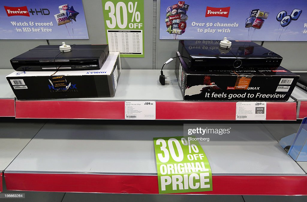 Freeview television signal receivers, manufactured by Humax Co. Ltd., sit above an empty shelf inside a Comet electronics store in Slough, U.K., on Friday, Nov. 23, 2012. Comet, a U.K. electronics chain, appointed Deloitte LLP as insolvency administrator, less than a year after being bought by private-equity firm OpCapita LLP. Photographer: Chris Ratcliffe/Bloomberg via Getty Images