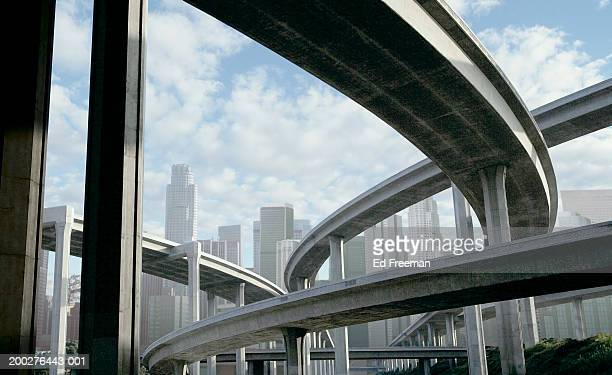 Freeway and office buildings, low angle view (digital composite)