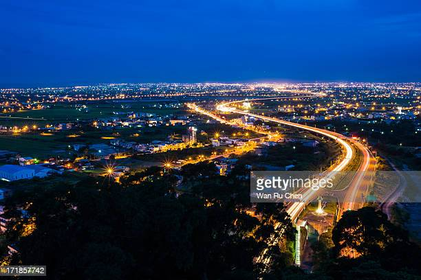 Freeway in night with cars light