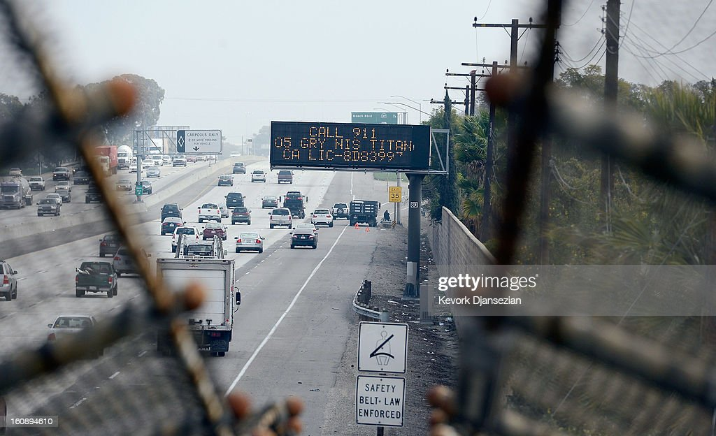 A freeway sign on the 91 Freeway flashes the car information of the getaway car believed to be used by a former Los Angeles police officer Christopher Jordan Dorner, 33, on February 7, 2013 in Buena Park, California. A former Los Angeles police officer Christopher Jordan Dorner, 33, who had allegedly warned he would target law enforcement, is suspected of firing on two LAPD officers and ambushing two other officers, killing one. Dorner is also a suspect in two weekend killings of Monica Quan and Keith Lawrence who were found dead in a car inside a parking structure.