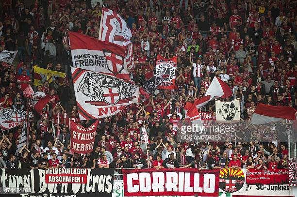 Freiburg fans cheer during German first division Bundesliga football match Hannover 96 vs SC Freiburg at the HDIArena in Hanover northern Germany on...