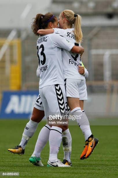 Freiburg players celebrate at the end of the women Bundesliga match between Bayern Muenchen and SC Freiburg at Stadion an der Gruenwalder Strasse on...