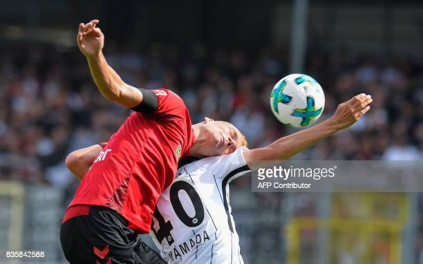 Freiburg's Austrian defender Philipp Lienhart and Frankfurt's Japanese midfielder Daichi Kamada vie for the ball during the German first division...