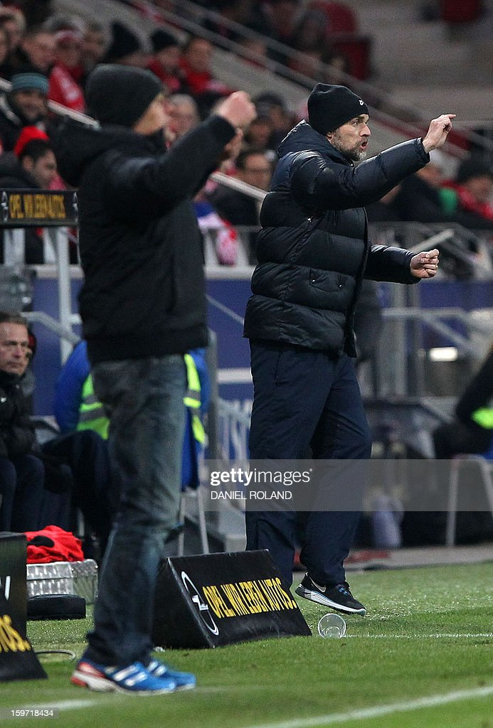 Freiburg's coach Christian Streich (L) and Mainz' coach Thomas Tuchel (R) during the German first division Bundesliga football match FSV Mainz 05 vs SC Freiburg in Mainz, southwestern Germany, on January 19, 2012. AFP PHOTO / DANIEL ROLAND
