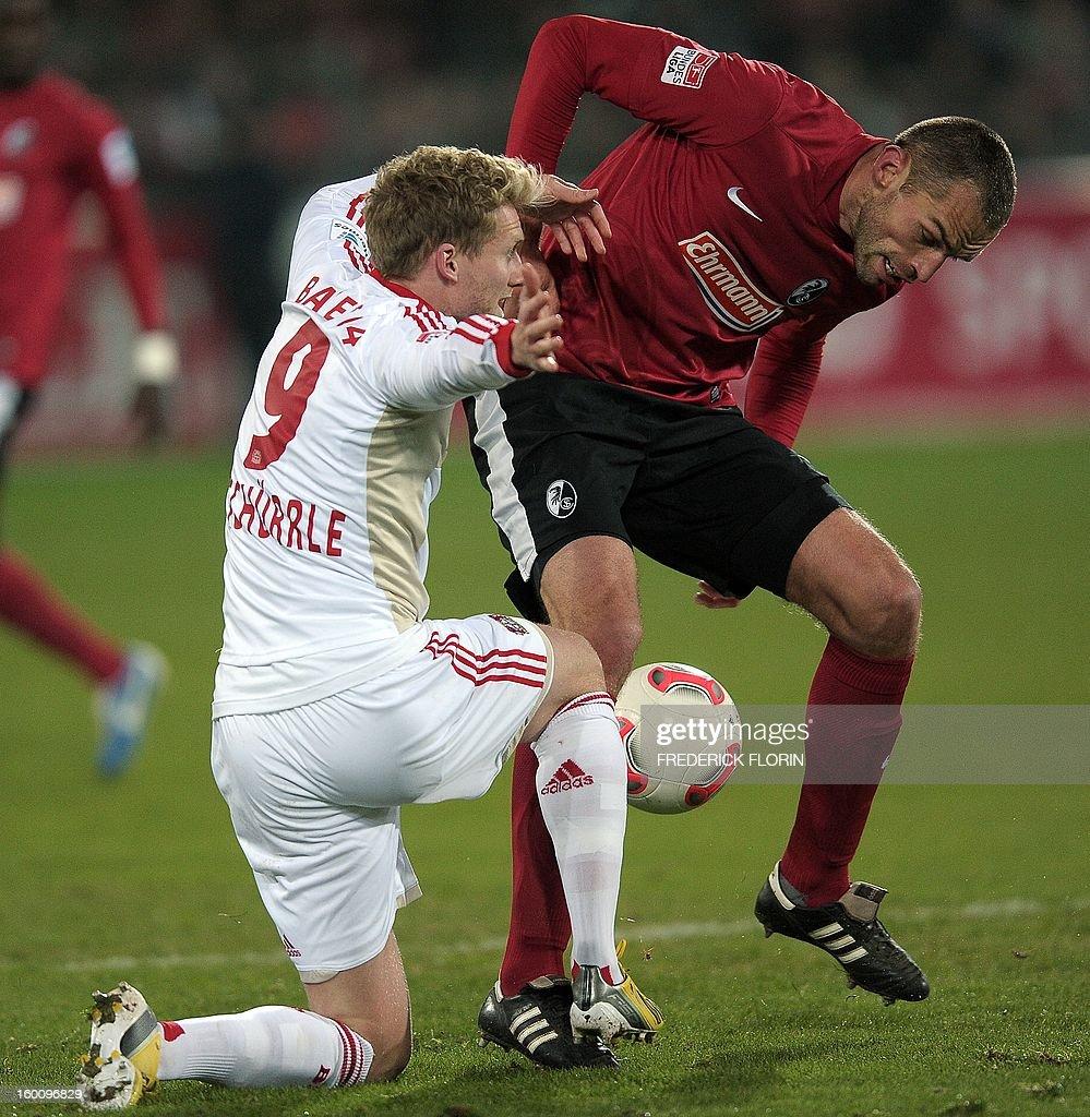 Freiburg's Czech defender Pavel Krmas (R) vies with Leverkusen's German forward Andre Schuerrle during the German first division Bundesliga football match SC Freiburg vs Bayer 04 Leverkusen in Freiburg, southern Germany, on January 26, 2013.