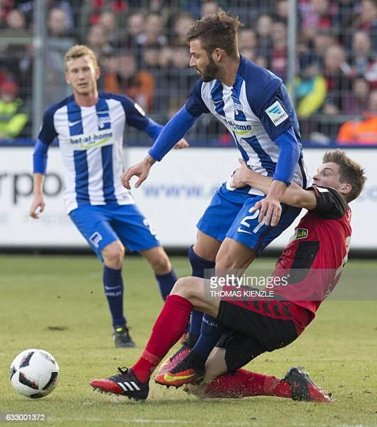 Freiburg's defender Lukas Kuebler and Berlin's defender Marvin Plattenhardt vie for the ball during the German first division Bundesliga football...