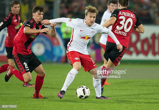 Freiburg's defender Pascal Stenzel and Leipzig's Swedish forward Emil Forsberg vie for the ball during the German first division Bundesliga football...