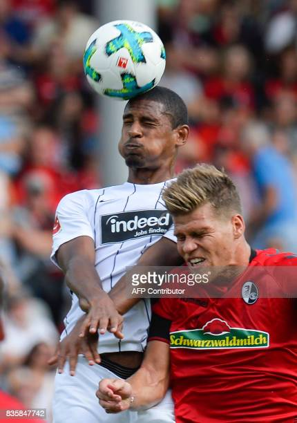 Freiburg's forward Florian Niederlechner and Frankfurt's French forward Sebastien Haller vie for the ball during the German first division Bundesliga...