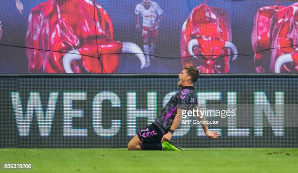 Freiburg's forward Florian Niederlechner celebrates after scoring the first goal during the German first division Bundesliga football match between...
