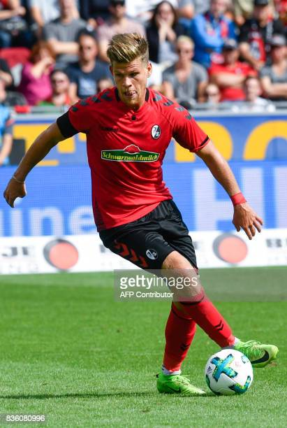 Freiburg's forward Florian Niederlechner controls the ball during the German First division Bundesliga football match SC Freiburg v Eintracht...