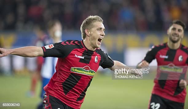Freiburg's forward Nils Petersen celebrates his goal during the German first division Bundesliga football match between SC Freiburg and Hertha Berlin...
