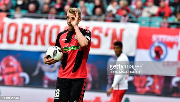 Freiburg's forward Nils Petersen explains to the referee that he was not off side for his goal during the German First division Bundesliga football...
