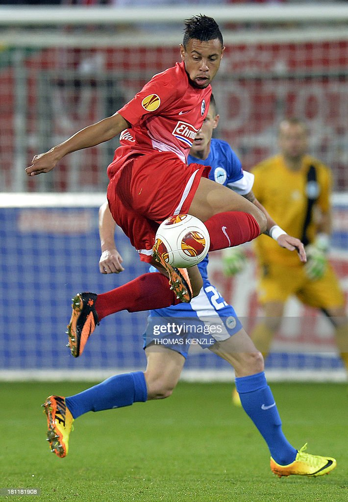 Freiburg's French midfielder Francis Coquellin (front) and Liberec's midfielder Jiri Fleisman vie for the ball during Europa league football match between SC Freiburg vs FC Slovan Liberec in Freiburg on September 19, 2013.