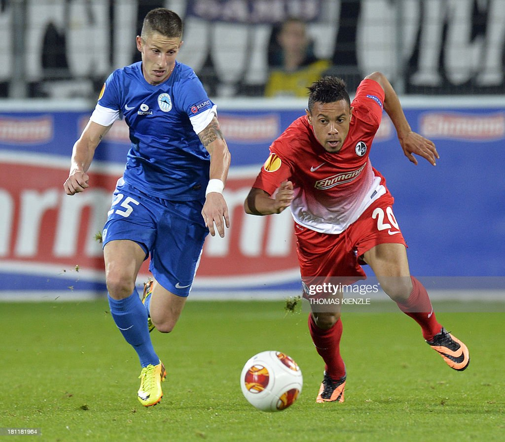 Freiburg's French midfielder Francis Coquellin (R) and Liberec's midfielder Jiri Fleisman vie for the ball during Europa league football match between SC Freiburg vs FC Slovan Liberec in Freiburg on September 19, 2013.