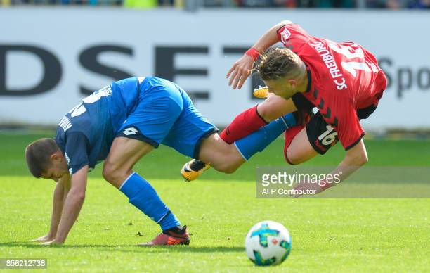 TOPSHOT Freiburg's German forward Florian Niederlechner and Hoffenheim's Croatian forward Andrej Kramaric vie for the ball during the German first...