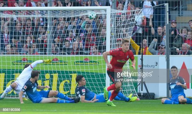 Freiburg's German forward Florian Niederlechner celebrates after scoring during the German first division Bundesliga football match SC Freiburg vs...