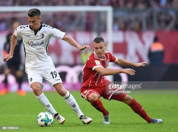 Freiburg's German forward Janik Haberer and Bayern Munich's German midfielder Joshua Kimmich vie for the ball during the German First division...