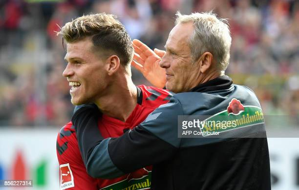 Freiburg's German head coach Christian Streich and Freiburg's German forward Florian Niederlechner react after the German first division Bundesliga...