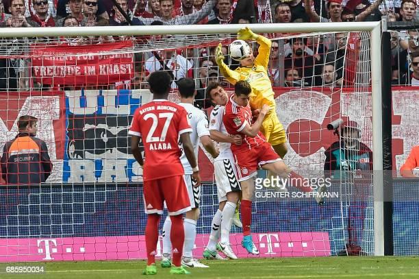 Freiburg's goalkeeper Alexander Schwolow makes a save during the German First division Bundesliga football match Bayern Munich vs SC Freiburg in...