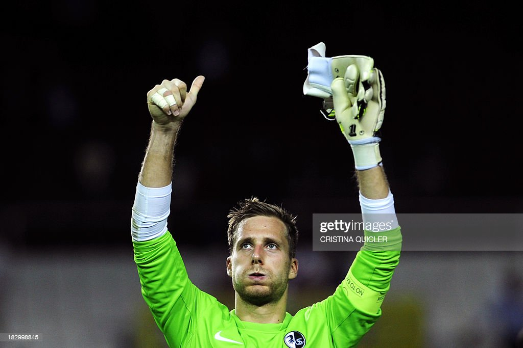 Freiburg's goalkeeper Oliver Baumann gives the thumbs up as he acknowledges the crowd at the end of the UEFA Europa league, group H, football match Sevilla FC vs SC Freiburg at the Ramon Sanchez Pizjuan stadium in Sevilla on October 3, 2013. Sevilla won the match 2-0.