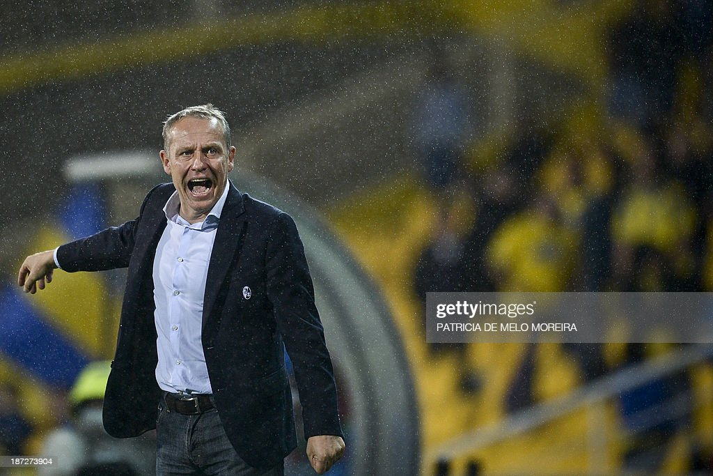 Freiburg's head coach Christian Streich reacts during the UEFA Europa League group H football match Estoril vs SC Freiburg at the Antonio Coimbra da Mota stadium on November 7, 2013.
