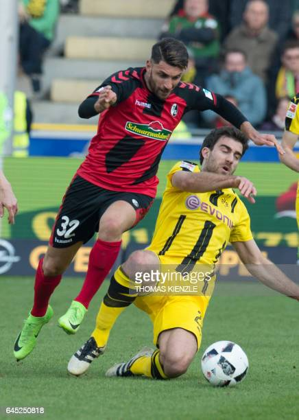 Freiburg's Italian midfielder Vincenzo Grifo and Dortmund's Greek defender Sokratis Papastathopoulos vie for the ball during the first German...