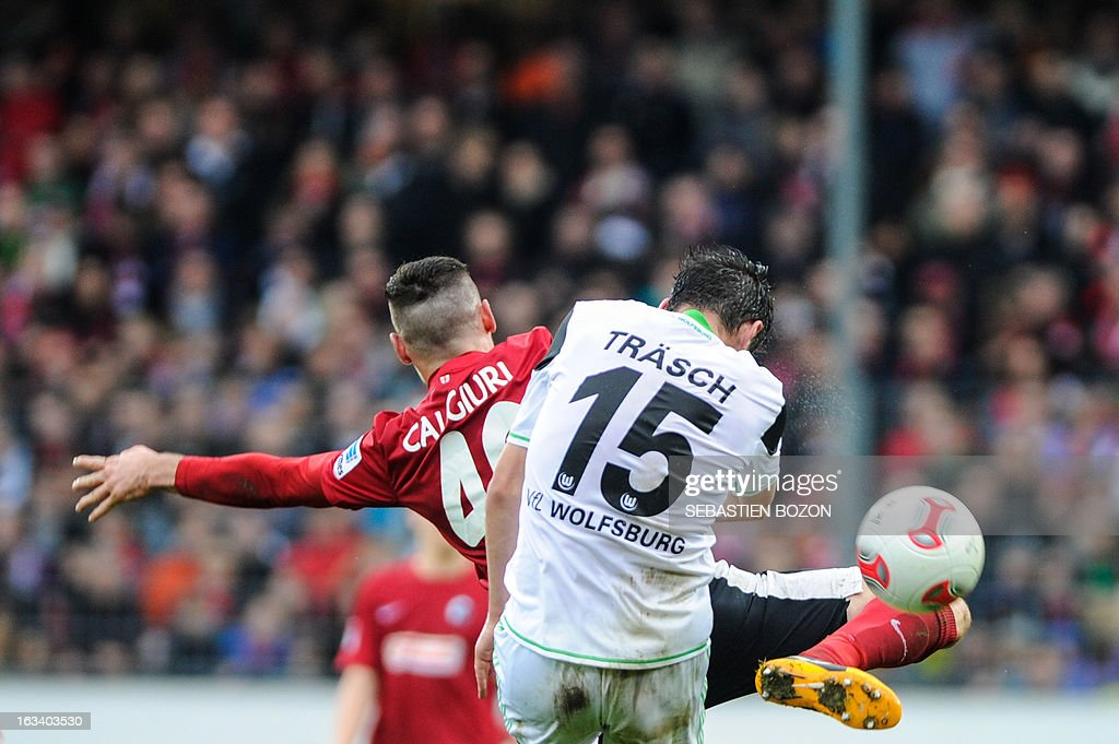 Freiburg's midfielder Daniel Caligiuri (L) and Wolfsburg's midfielder Christian Traesch vie for the ball during the German first division Bundesliga football match SC Freiburg vs Wolfsburg in Freiburg, southern Germany, on March 9, 2013.