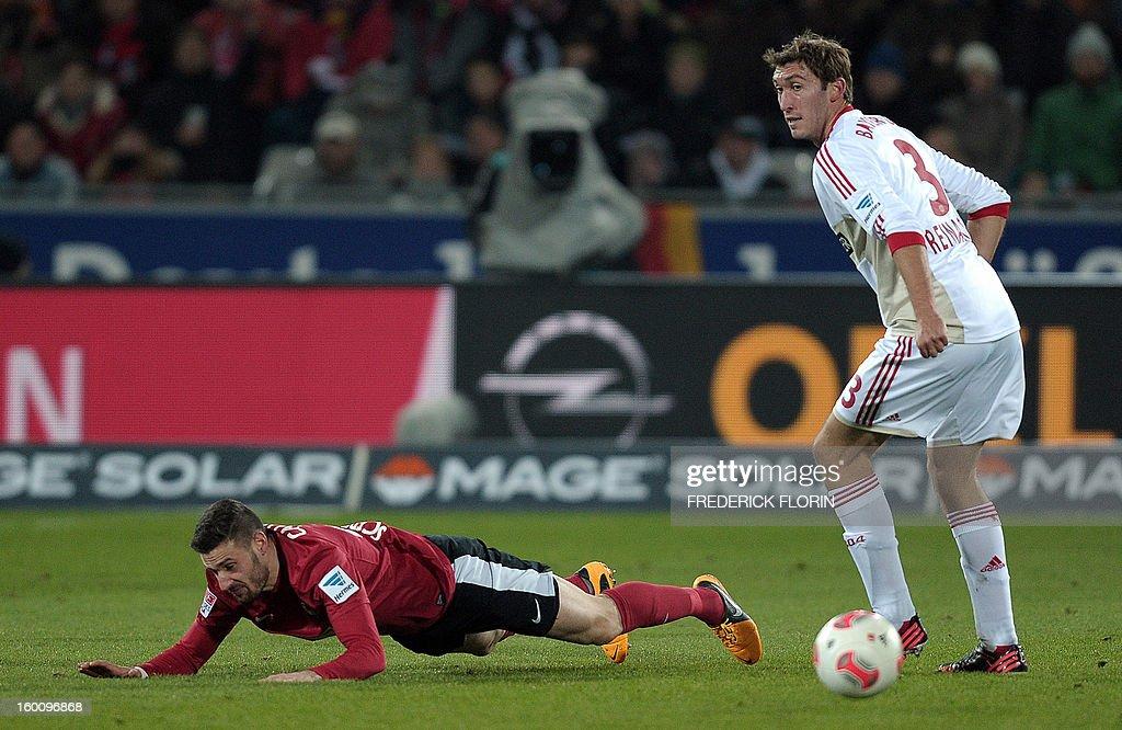 Freiburg's midfielder Daniel Caligiuri (L) vies with Leverkusen's midfielder Stefan Reinartz during the German first division Bundesliga football match SC Freiburg vs Bayer 04 Leverkusen in Freiburg, southern Germany, on January 26, 2013.