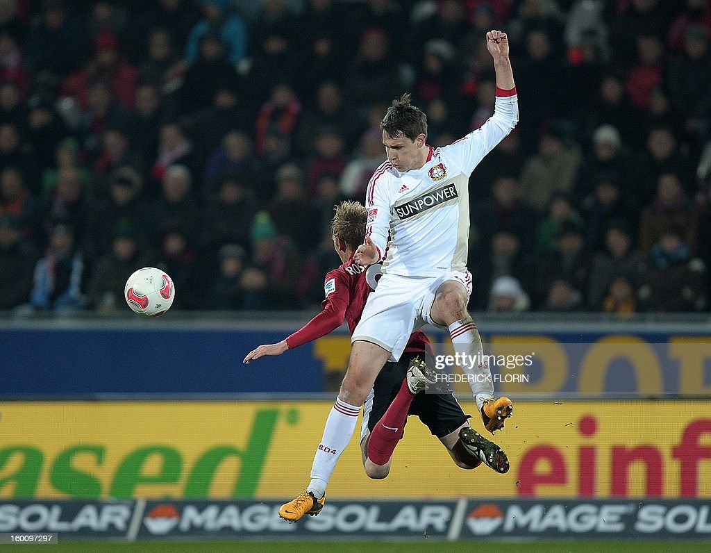 Freiburg's midfielder Jan Rosenthal (L) vies with Leverkusen's defender Philipp Wollscheid during the German first division Bundesliga football match SC Freiburg vs Bayer 04 Leverkusen in Freiburg, southern Germany, on January 26, 2013.
