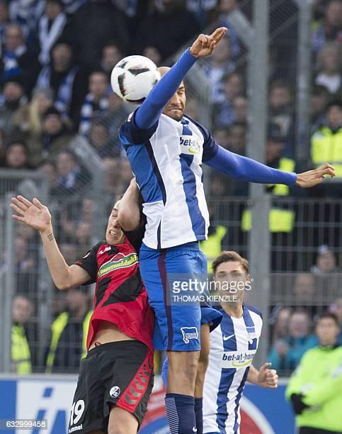 Freiburg's midfielder Janik Haberer and Berlin's US defender John Anthony Brooks vie for the ball during the German first division Bundesliga...