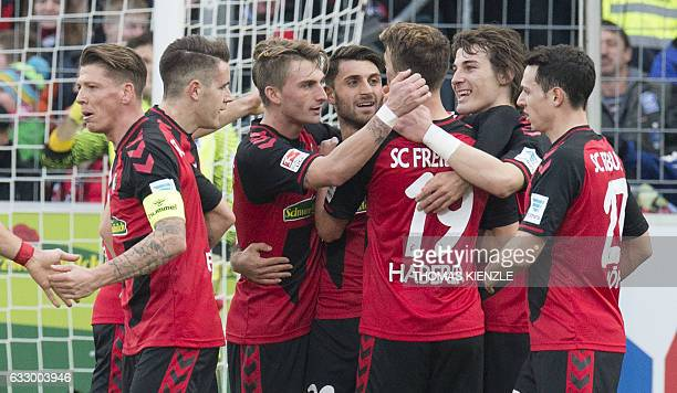 Freiburg's midfielder Janik Haberer and his teammates celebrate the goal during the German first division Bundesliga football match between SC...