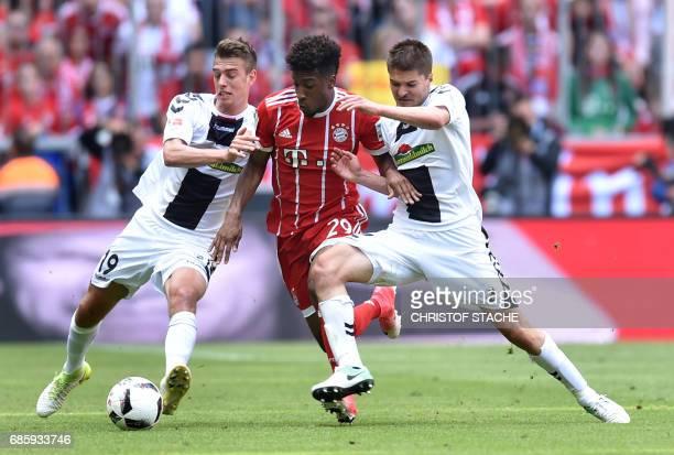 Freiburg's midfielder Janik Haberer Bayern Munich's French midfielder Kingsley Coman and Freiburg's Serbian defender Aleksandar Ignjovski vie for the...