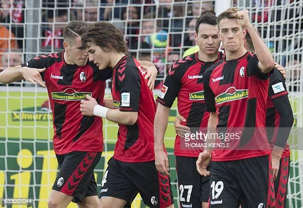 Freiburg's midfielder Janik Haberer celebrates with teammates after scoring during the German first division Bundesliga football match between SC...