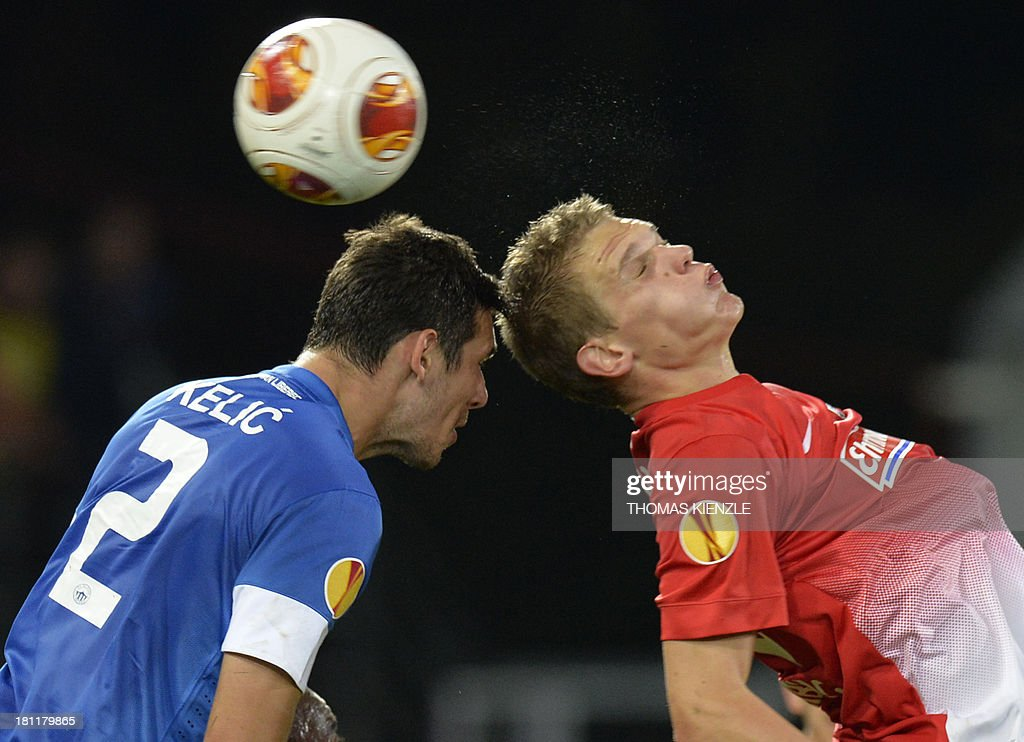 Freiburg's midfielder Matthias Ginter (R) and Liberec's Croatian defender Renato Kelic vie for the ball during Europa league football match between SC Freiburg vs FC Slovan Liberec in Freiburg on September 19, 2013.