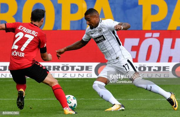Freiburg's midfielder Micolas Hoefler and Frankfurt's Ghanaian midfielder KevinPrince Boateng vie for the ball during the German first division...