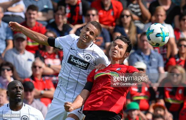 Freiburg's midfielder Nicolas Hoefler and Frankfurt's Serbian midfielder Mijat Gacinovic vie for the ball during the German First division Bundesliga...