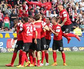 Freiburg's players celebrate after the German first division Bundesliga football match SC Freiburg vs FC Bayern Munich in Freiburg southern Germany...
