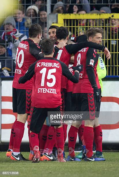 Freiburg's players celebrate their opening goal during the German first division Bundesliga football match SC Freiburg vs FC Bayern Munich in...