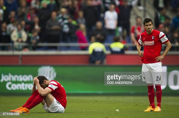 Freiburg's Serbian defender Stefan Mitrovic and Freiburg's Bosnian defender Mensur Mujdza react at the final whistle of the German first division...