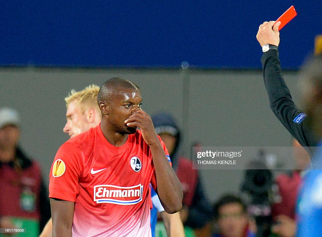 Freiburg's Slovak midfielder Karim Guede gets the red card during Europa league football match between SC Freiburg vs FC Slovan Liberec in Freiburg on September 19, 2013.