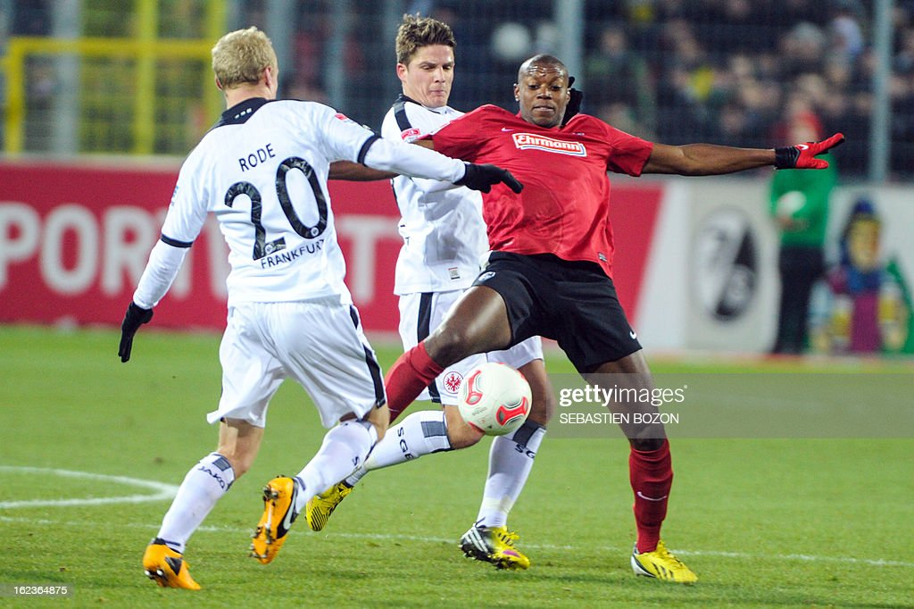 Freiburg's Slovak midfielder Karim Guede (R) vies with Frankfurt's German midfielder Sebastian Rode (L) and Frankfurt's Swiss midfielder Pirmin Schwegler (C) during German first divison Bundesliga match SC Freiburg vs Eintracht Frankfurt on February 22, 2013 in Freiburg.