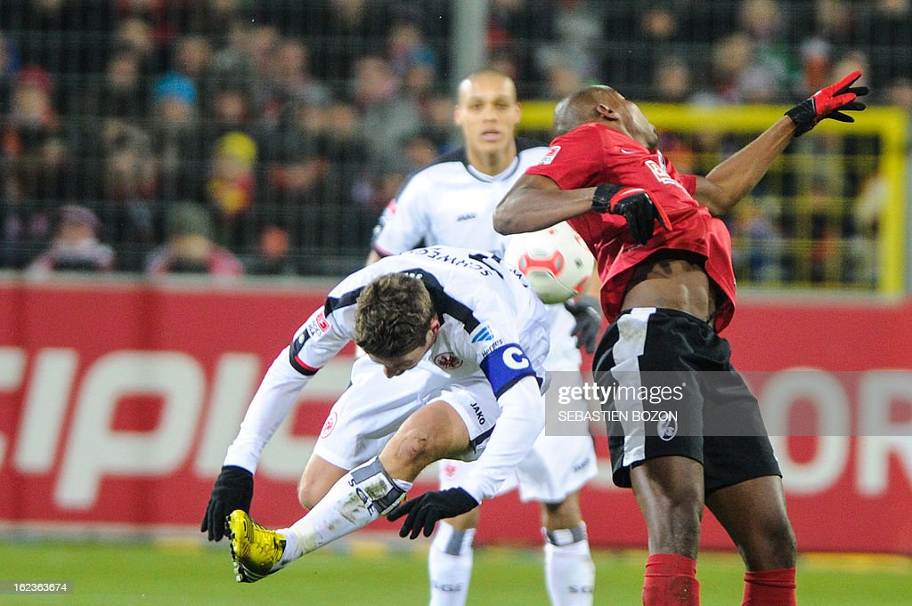 Freiburg's Slovakian midfielder Karim Guede (R) vies with Frankfurt's Swiss midfielder Pirmin Schwegler (L) during German first divison Bundesliga match SC Freiburg vs Eintracht Frankfurt on February 22, 2013 in Freiburg.