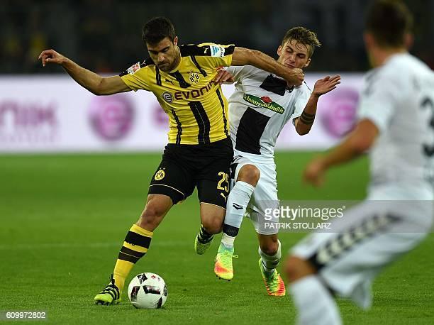 Freiburg´s striker Maximilian Philipp and Dortmund's Greek defender Sokratis vie for the ball during the German first division Bundesliga football...