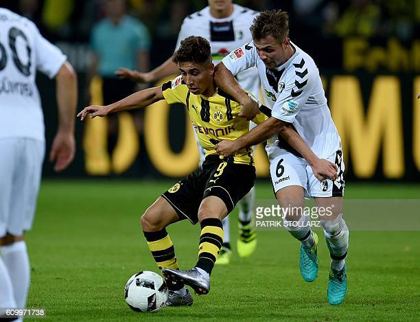 Freiburg´s striker Maximilian Philipp and Dortmund's Turkish midfielder Emre Mor vie for the ball during the German first division Bundesliga...