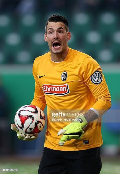 Freiburg's Swiss goalkeeper Roman Buerki reacts during the German Football Cup DFB Pokal quarterfinal football match between VfL Wolfsburg and SC...
