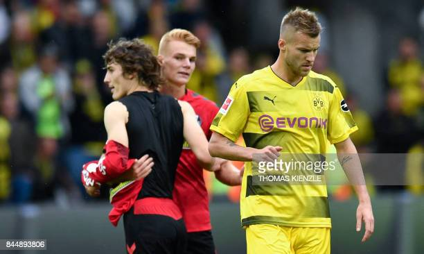 Freiburg's Turkish defender Caglar Soyuncu Freiburg's Austrian defender Philipp Lienhart and Dortmund's Ukrainian forward Andrey Yarmolenko react...