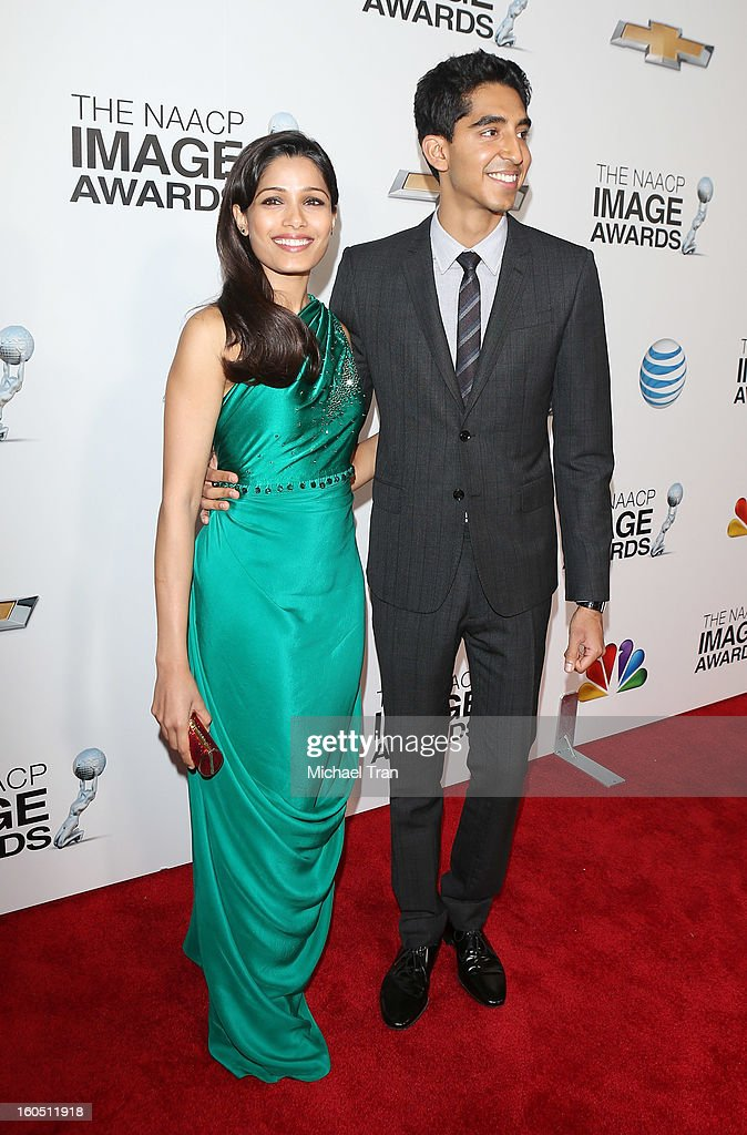 Freida Pinto (L) and Dev Patel arrive at the 44th NAACP Image Awards held at The Shrine Auditorium on February 1, 2013 in Los Angeles, California.